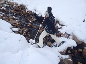 Snowshoeing Across a Small Creek