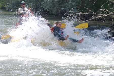 Woman getting splashed Weber River rapid drop