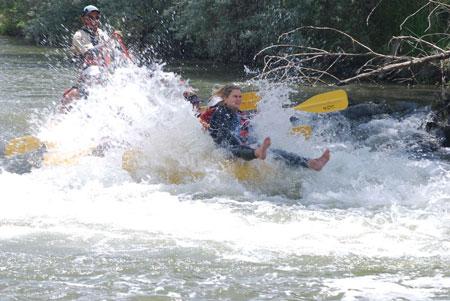 Woman getting splashed Weber River rapid drop
