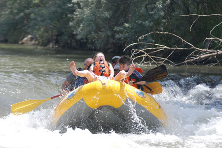Girl riding front of raft on Weber River