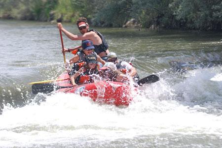 Weber River raft guide paddling rapid