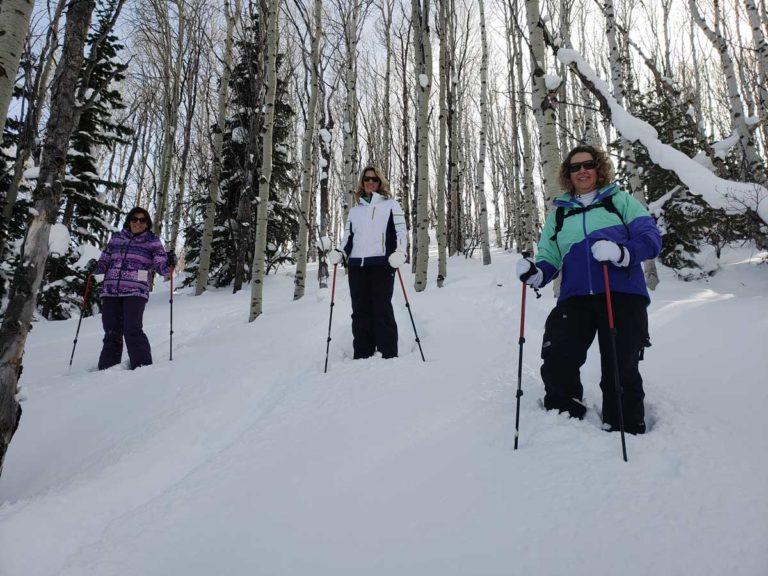 Women Snowshoeing in Aspens