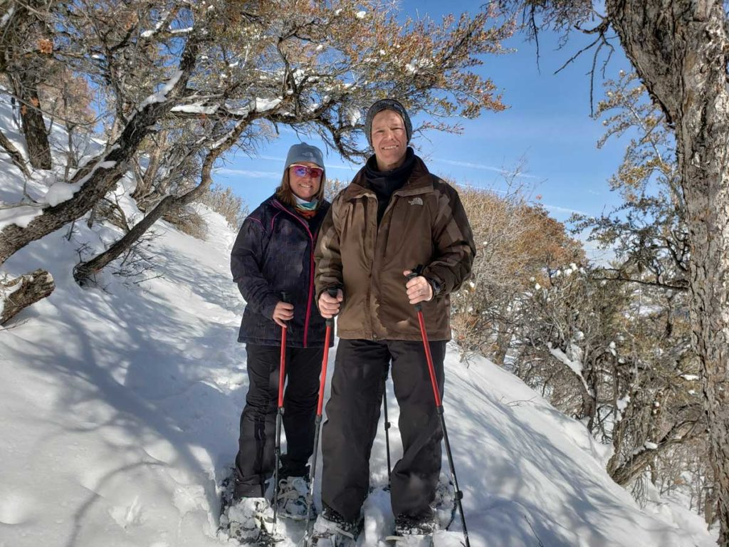 Couple Snowshoeing in Aspens