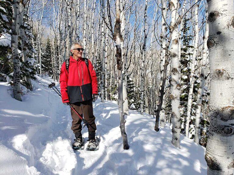 Man Snowshoeing Aspens