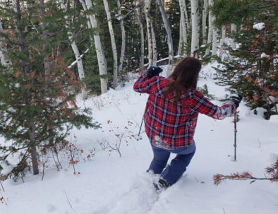 Snowshoeing down a hill