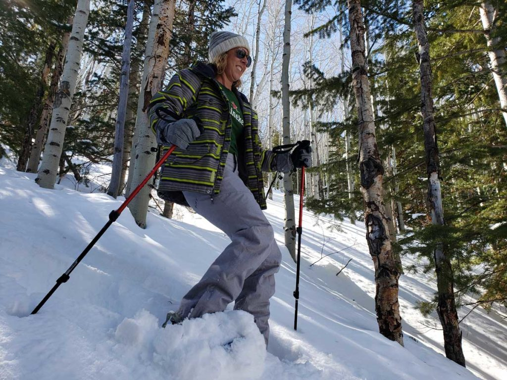Woman Breaking Through Powder on Snowshoes